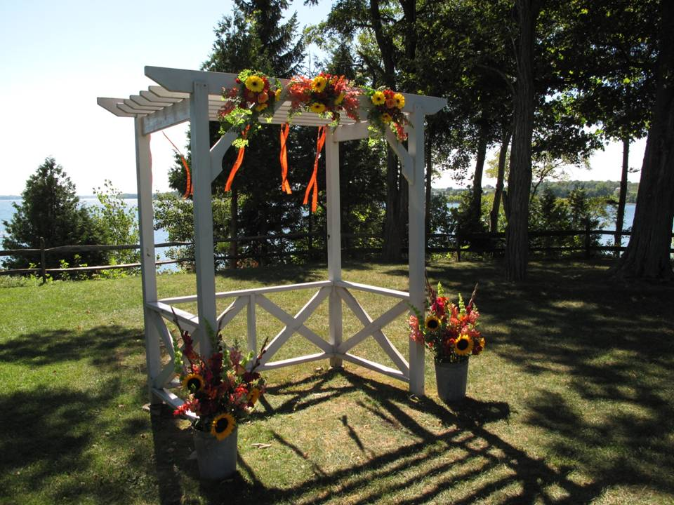 Fall Wedding at Grand Isle Lake House Wedding arbor at Grand Isle Lake