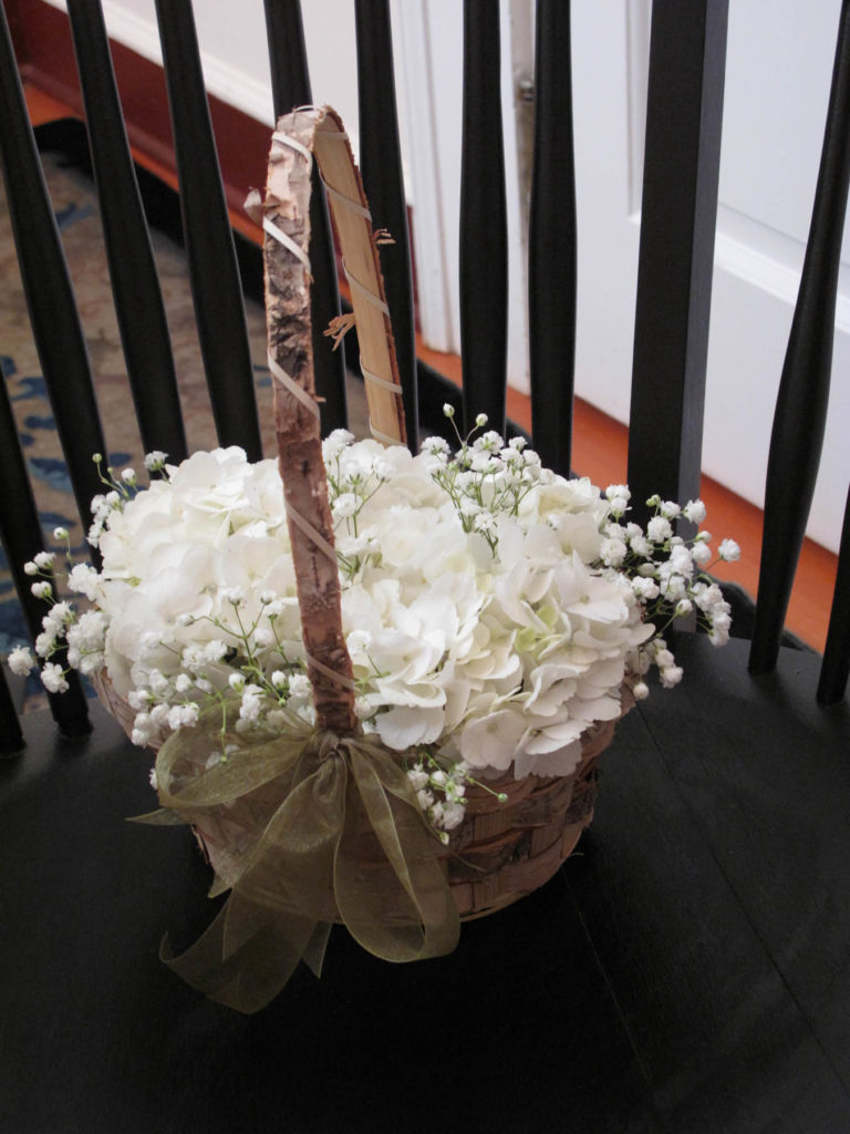Classic white hydrangeas and baby's breath flower girl basket