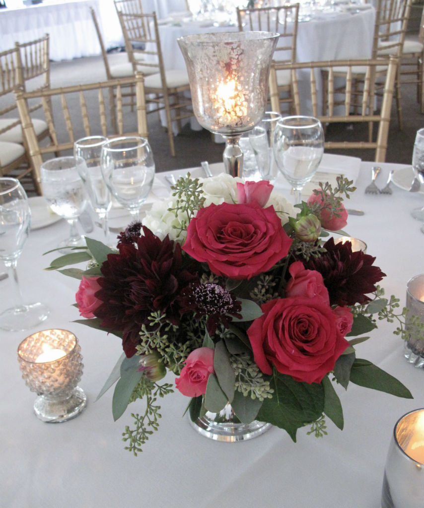 Burgundy and raspberry wedding flowers at topnotch resort