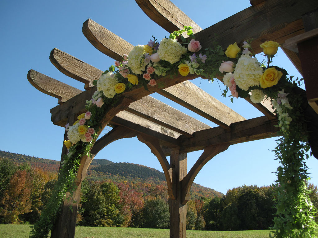 flowers on wedding arbor, Vermont Wedding