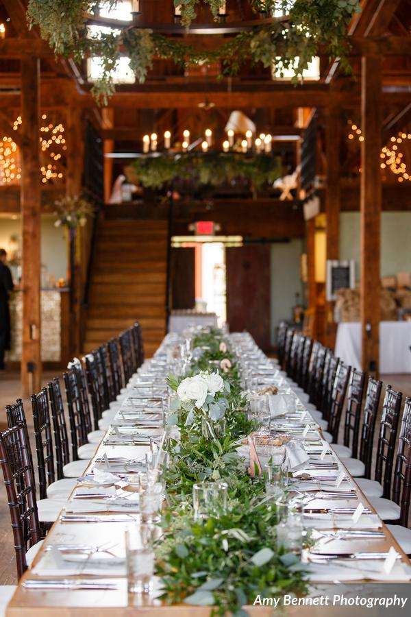 Fresh table runner, garland centerpiece, Floral Artistry by Alison Ellis, Wedding at The Lang Barn in Essex, VT