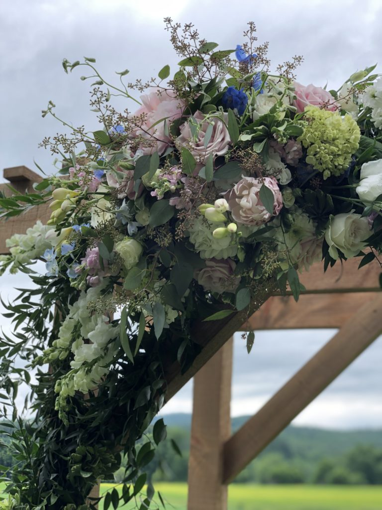 Wedding arbor by Floral Artistry in Vermont