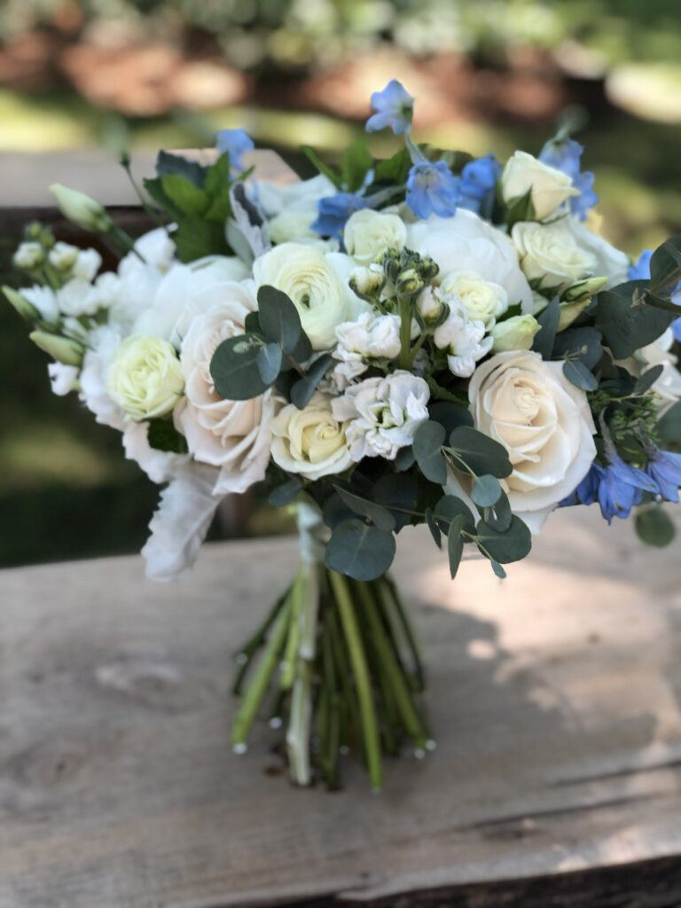 bouquet of white and blue flowers